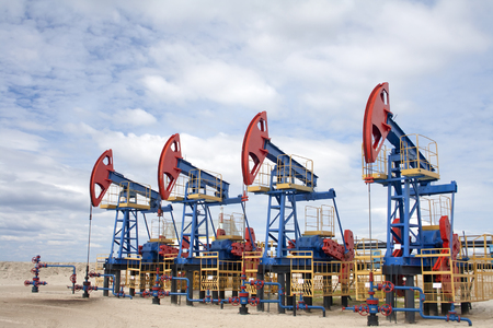 Oil industry and gas industry. Work of oil pump jack on a oil field. Oil equipment Stock Photo