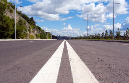 Empty street to big city. Blue sky and white cloud Stock Photo