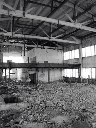 Destroyed factory. Building in ruins. Black and white photo