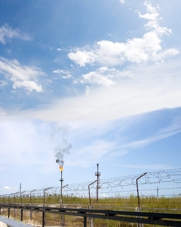 Oil industry. Work of refinery plant. Gas industry. Gas torch on petrochemical factory