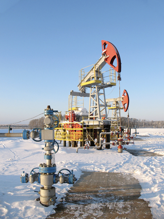 Oi industry and gas industry. Work of oil pump jack on a oil field. Oil equipment Stock Photo