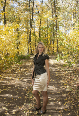 Young girl in beauty autumn forest