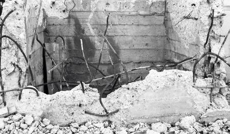 Ruins of building after conflict. Black and white photo Stock Photo