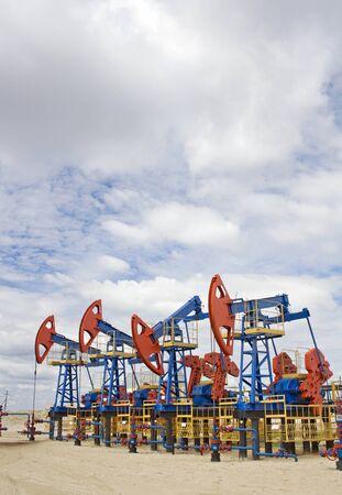 Oil pumps in desert. Oil industry. Gas refinery