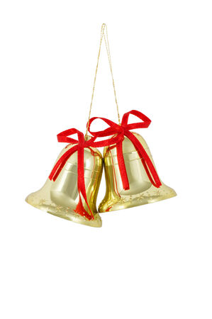 Two gold bell with a red ribbon