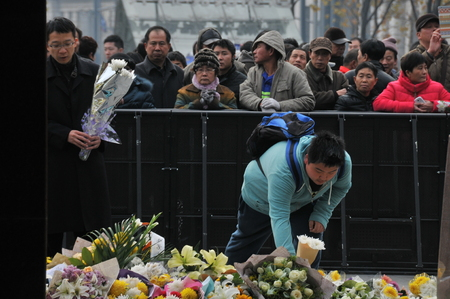 victims: Shanghai Bund people mourn stampede victims