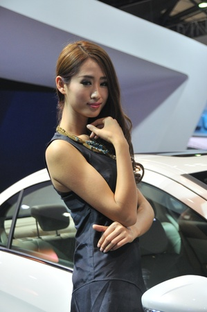 charm temptation: Unidentified female presenter at motor show