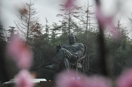 Deng Xiaoping statue with plum blossom