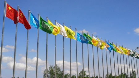 Flags waving under the clear blue sky Editorial