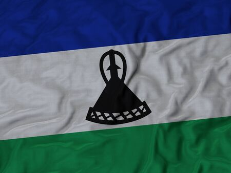 ruffled: Closeup of ruffled Lesotho flag, Ruffled flag background. Stock Photo