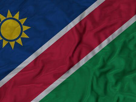 ruffled: Closeup of Ruffled Namibia flag, Fabric Ruffled Flag Background.