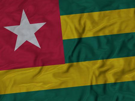 ruffled: Closeup of Ruffled Togo flag, Fabric Ruffled Flag Background.