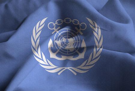Closeup of Ruffled International Maritime Organization Flag, International Maritime Organization Flag Blowing in Wind
