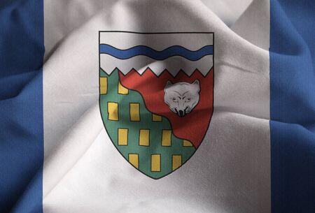 northwest: Closeup of Ruffled Northwest Territories Flag, Northwest Territories Flag Blowing in Wind Stock Photo