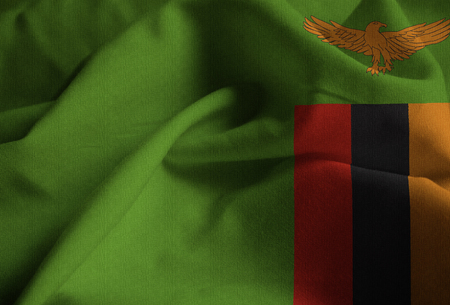 Closeup of Ruffled Zambia Flag, Zambia Flag Blowing in Wind Stock Photo