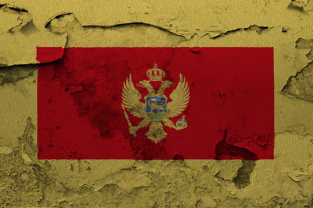 Painted national flag of Montenegro on a concrete wall