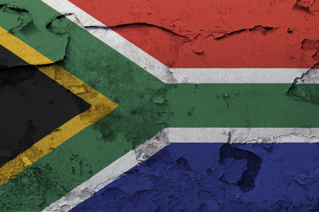 Painted national flag of South Africa on a concrete wall Фото со стока