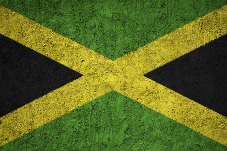 Jamaica flag on the grunge concrete wall