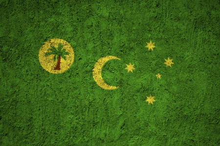 Cocos Islands flag on the grunge concrete wall