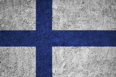 Finland flag on the grunge concrete wall