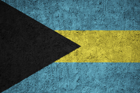 Bahamas flag on the grunge concrete wall