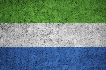 Sierra Leone flag on the grunge concrete wall