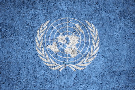 United Nations flag on the grunge concrete wall