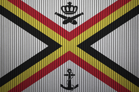 Naval Ensign of Belgium flag on the grunge concrete wall Фото со стока