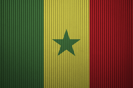 Painted national flag of Senegal on a concrete wall Фото со стока