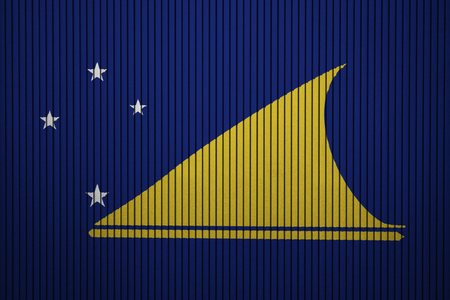Painted national flag of Tokelau on a concrete wall