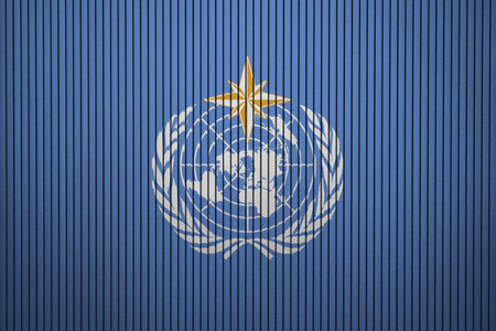 World Meteorological Organization flag painted on the concrete wall Foto de archivo