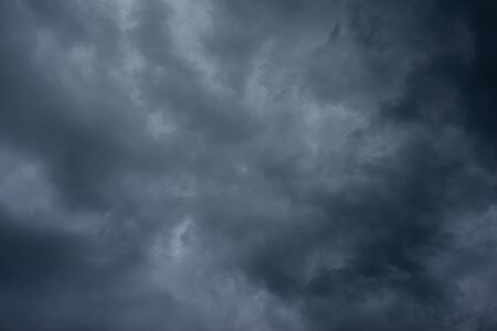 Dark black clouds in the sky, Stormy rain clouds background. Stock Photo