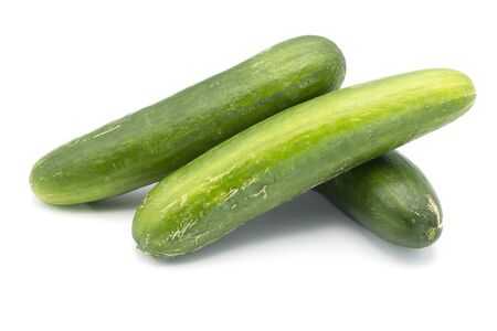 Three cucumbers on an isolated white background