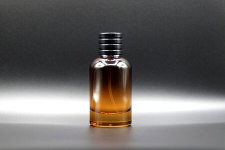 Red color glass perfume bottle without label or sticker in a black background