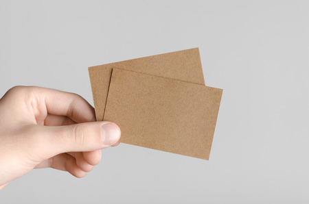 kraft business card mock up 85x55mm male hands holding kraft cards on - Kraft Business Cards
