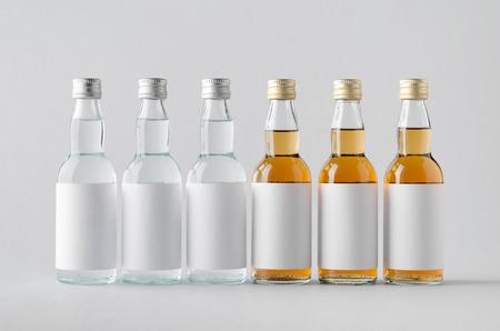 rakia: Miniature SpiritsLiquour Bottle Mock-Up - Multiple Bottles. Blank Label Stock Photo