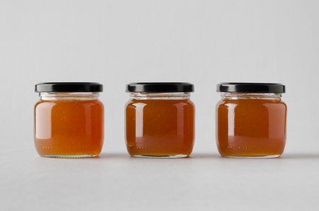 Apricot Jam Jar Mock-Up - Three Jars Banco de Imagens - 80544465