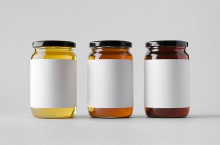 Honey Jar Mock-Up - Drie Potten. Blanco label Stockfoto