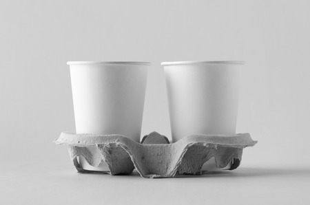 Two 12 oz. white coffee paper cups without lid in a holder. Blank Mock-Up. Banco de Imagens