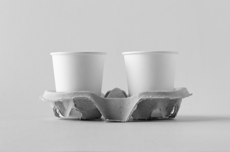 Two 8 oz. white coffee paper cups without lid in a holder. Blank Mock-Up. Banco de Imagens