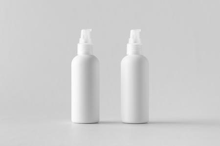 White plastic cosmetic foam pump bottle mock-up.
