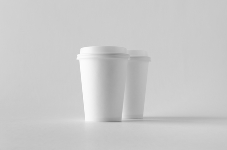 12 oz. white coffee paper cup mock-up with lid. Banco de Imagens