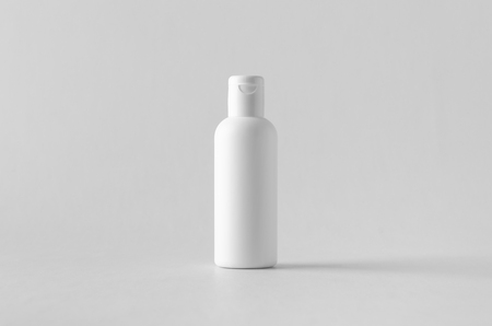 White plastic cosmetic lotion bottle mock-up with cap.