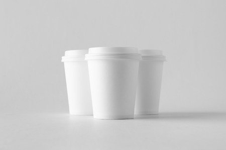 8 oz. white coffee paper cup mock-up with lid. Banco de Imagens - 115963489