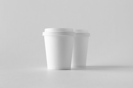 8 oz. white coffee paper cup mock-up with lid. Banco de Imagens - 115963491