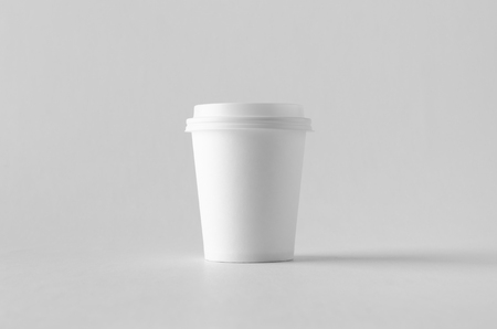 8 oz. white coffee paper cup mock-up with lid. Banco de Imagens - 115963498