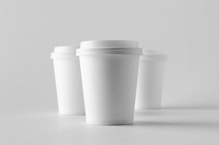 8 oz. white coffee paper cup mock-up with lid. Banco de Imagens - 115963502