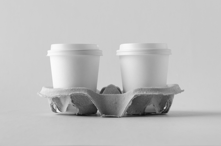 Two 8 oz. white coffee paper cups with lid in a holder. Blank Mock-Up. Banco de Imagens - 115963507