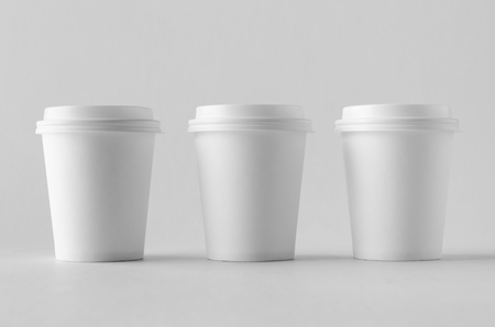 8 oz. white coffee paper cup mock-up with lid. Banco de Imagens - 115963526
