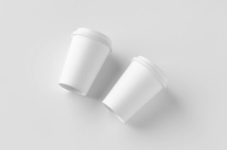 12 oz. white coffee paper cup mockup with lid. Banco de Imagens - 126253892